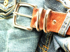 Tan belt and distressed denim